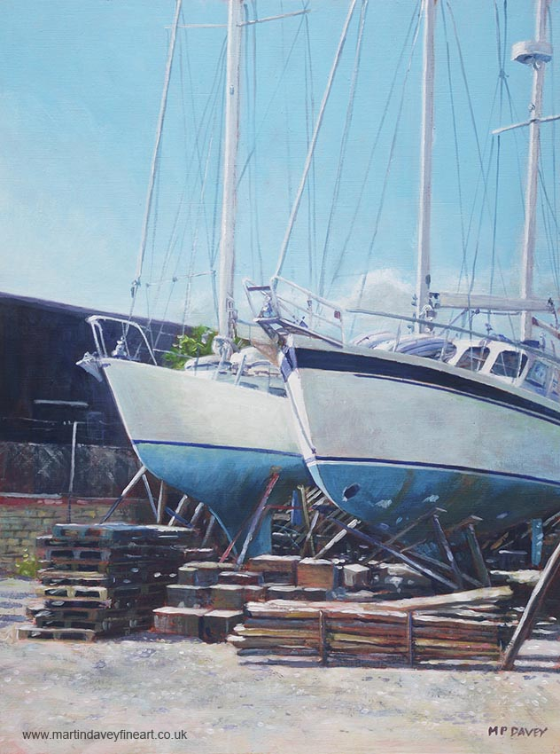 yachts under repair in Southampton boatyard painting
